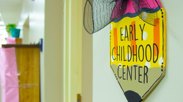 """photo of a wall pencil shaped wall hanging that reads """"Early Childhood Center"""""""