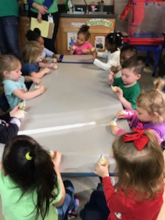 students enjoying an activity to practice teeth brushing on stained, hard-boiled eggs